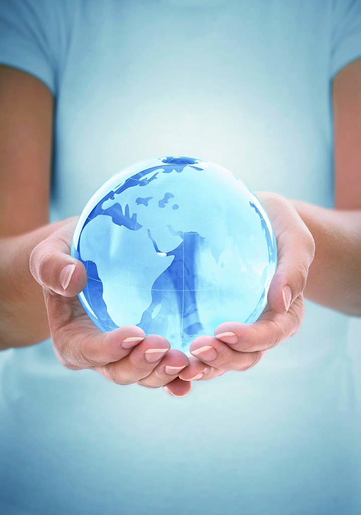 Glowing green transparent globe in hands, Africa, Europe and Asia focused.